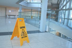 Caution wet floor sign in a new corporate building.